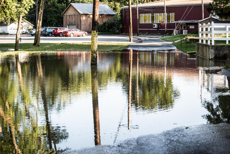 Flooded parking lot. A flooded parking lot. Natural Disaster royalty free stock photography