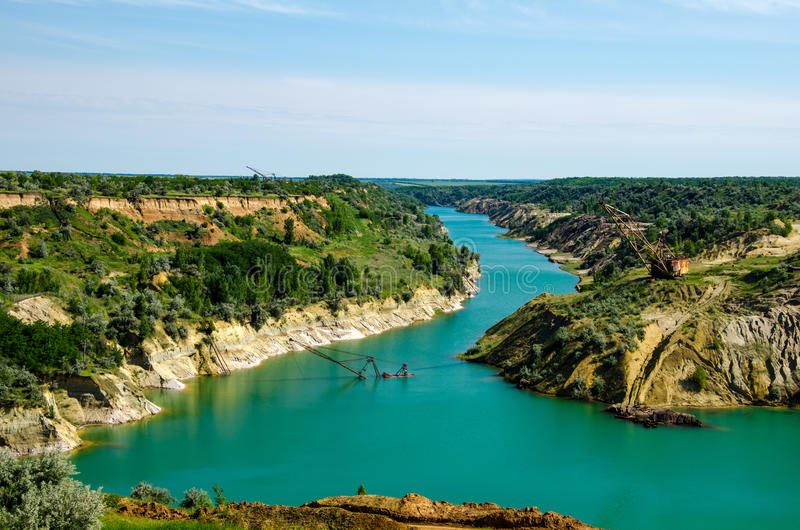 Flooded quarry. Abandoned flooded coal quarry in Ukraine royalty free stock photography
