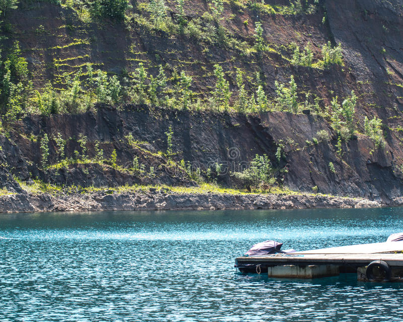 Flooded quarry and dive pontoon royalty free stock photos