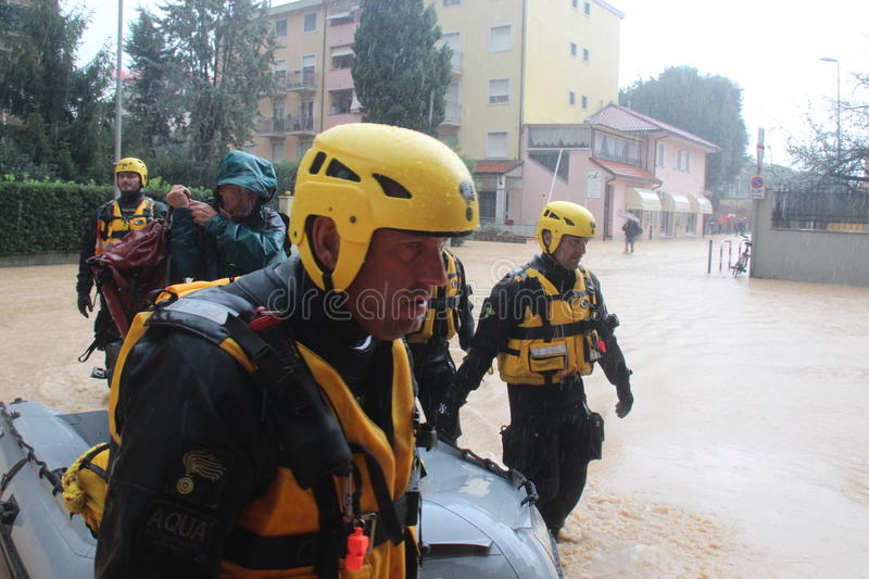 Flooded residential areas In Marina di Carrara and rescue. Images taken during the flooding of the Carrione River, Marina di Carrara (Tuscany, Italy) submerged stock images