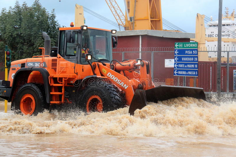 Flooded residential areas In Marina di Carrara and rescue. Images taken during the flooding of the Carrione River, Marina di Carrara (Tuscany, Italy) submerged stock photos