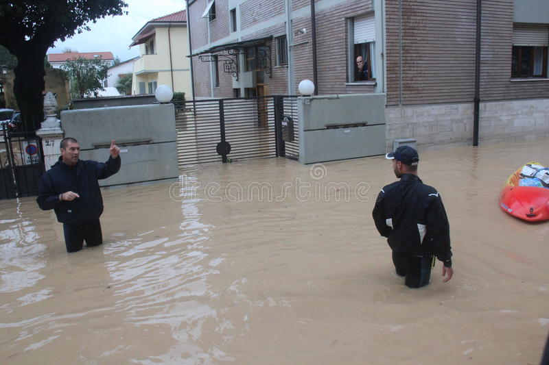 Flooded residential areas In Marina di Carrara and rescue. Images taken during the flooding of the Carrione River, Marina di Carrara (Tuscany, Italy) submerged royalty free stock images