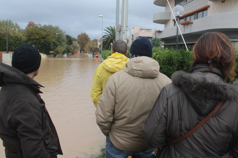 Flooded residential areas In Marina di Carrara and rescue. Images taken during the flooding of the Carrione River, Marina di Carrara (Tuscany, Italy) submerged stock photo