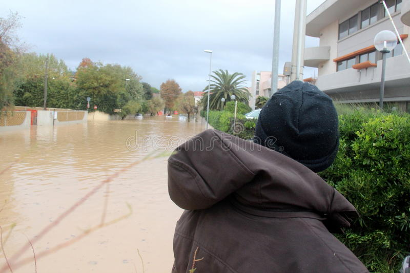 Flooded residential areas In Marina di Carrara and rescue. Images taken during the flooding of the Carrione River, Marina di Carrara (Tuscany, Italy) submerged royalty free stock photography