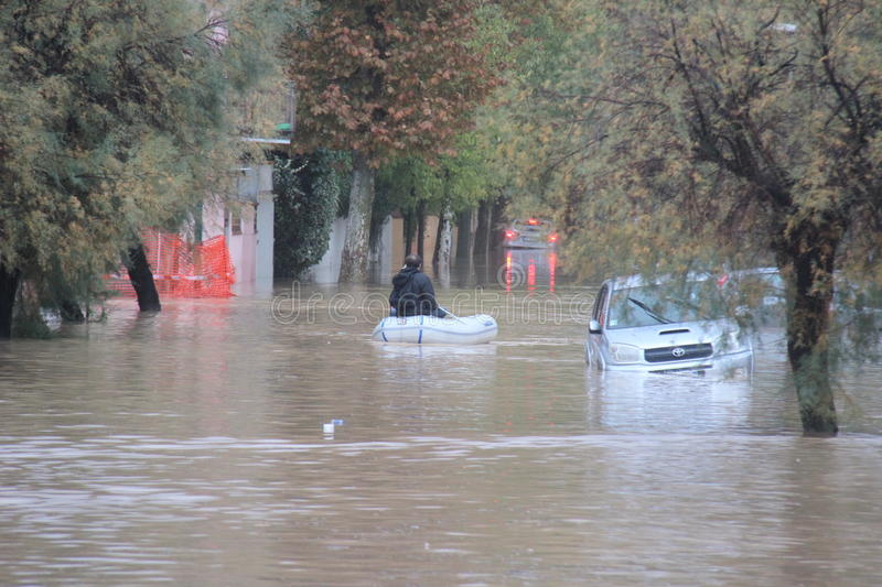 Flooded residential areas In Marina di Carrara and rescue. Images taken during the flooding of the Carrione River, Marina di Carrara (Tuscany, Italy) submerged royalty free stock image