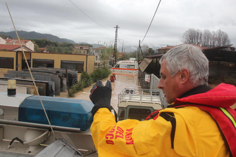 Flooded residential areas In Marina di Carrara and rescue. Images taken during the flooding of the Carrione River, Marina di Carrara (Tuscany, Italy) submerged stock photography