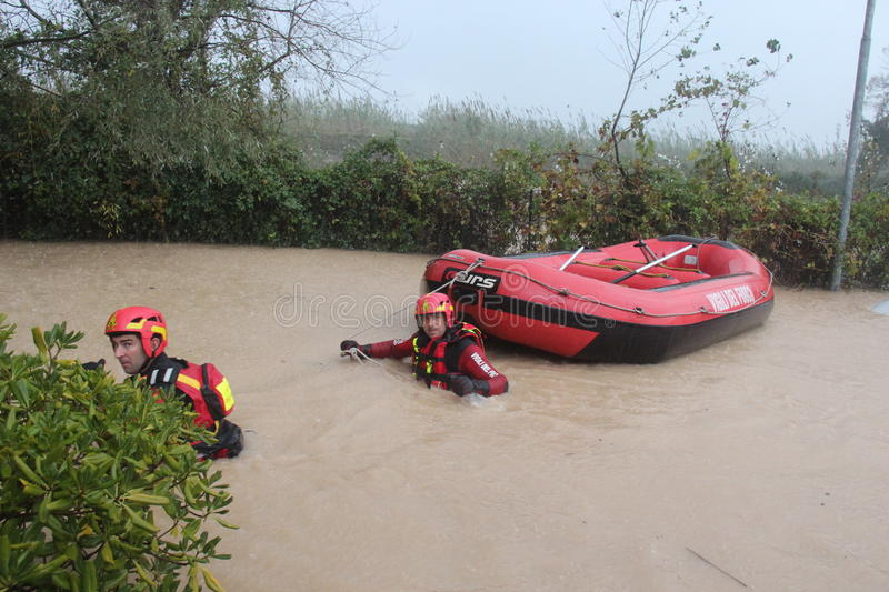 Flooded residential areas In Marina di Carrara and rescue. Images taken during the flooding of the Carrione River, Marina di Carrara (Tuscany, Italy) submerged royalty free stock photos