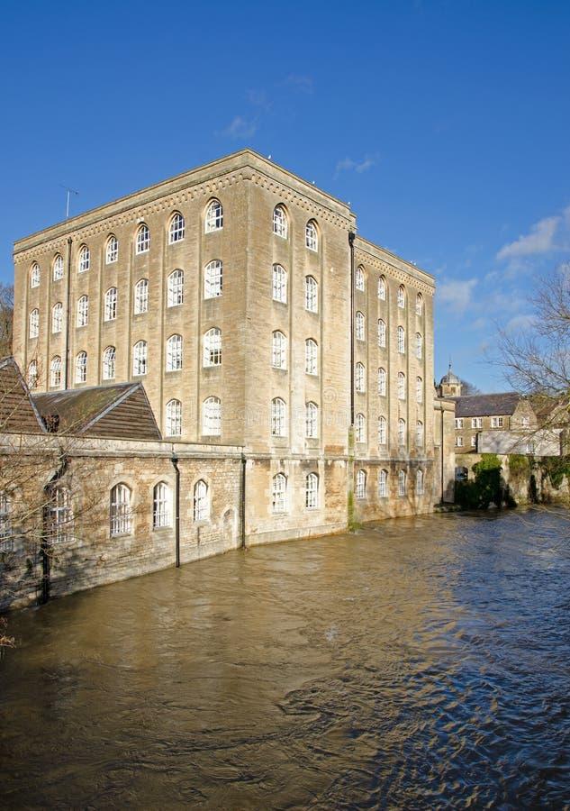 Flooded River Avon, Bradford on Avon, United Kingdom. Converted warehouse on a flooded River Avon, Bradford on Avon, United Kingdom stock photography
