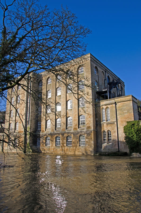 Flooded River Avon, Bradford on Avon, United Kingdom. Converted warehouse on a flooded River Avon, Bradford on Avon, United Kingdom stock photo