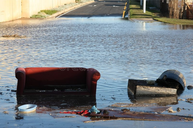 Flooded Road and couch stock images