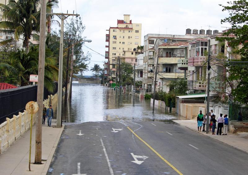Flooded street in Havana Cuba after a storm. Flooded road in Havana Cuba, caused by a recent storm. Taken after the storms in 2010 royalty free stock images