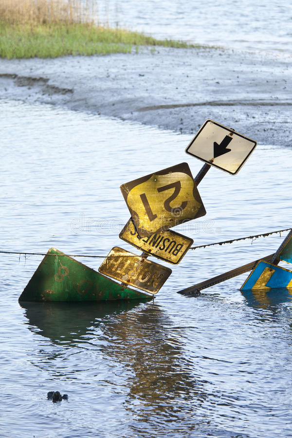 Road signs on flooded road royalty free stock images