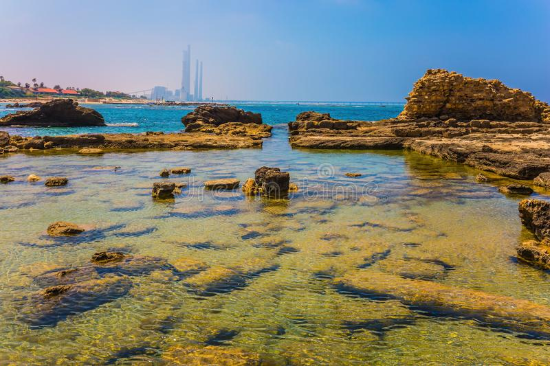 Flooded ruins of ancient military fortifications. Ruins of the ancient city and port of Caesarea. Flooded in the sea ruins and remains of ancient military royalty free stock image