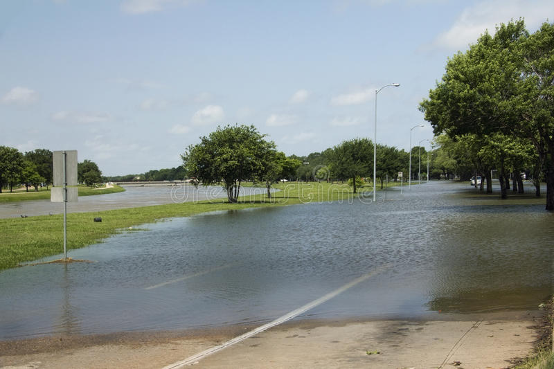 Flooded Street Near Bayou. Brays Bayou overflowed during Houston, Texas floods. Many residents and auto drivers were caught by surprise and forced to abandon royalty free stock photos