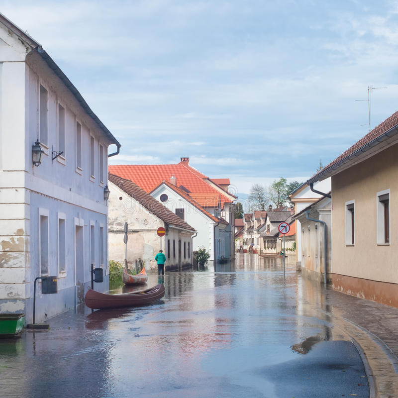 Flooded street. Rural village houses in floodwater. Road with the river overflown with the residents in their homes. River Krka floods and flooding the streets stock photos