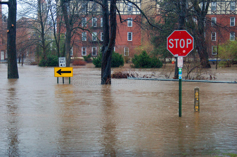 Flooded streets. A Suburban town is flooded during heavy rains stock photography