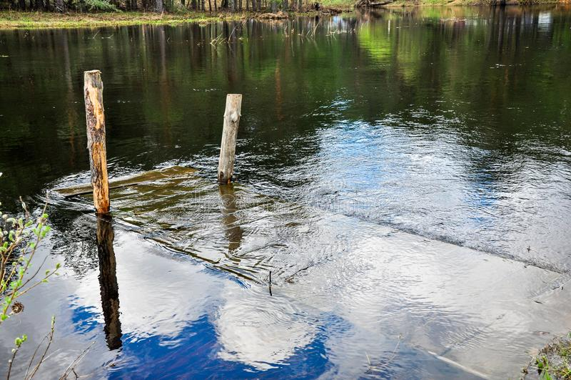 Flooded wooden bridge stock images