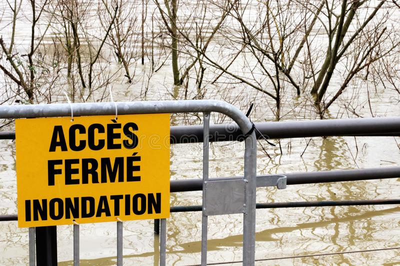 Flooded banks Seine Paris Access closed sign France royalty free stock photography