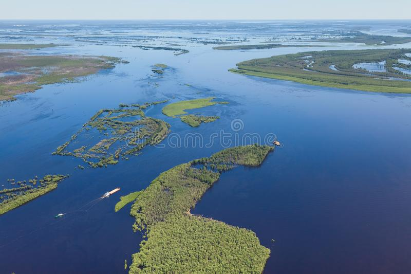Floodplain of Great river in spring, top view. Flooding of bottom land of the Big Siberian river Ob in spring period, top view stock image