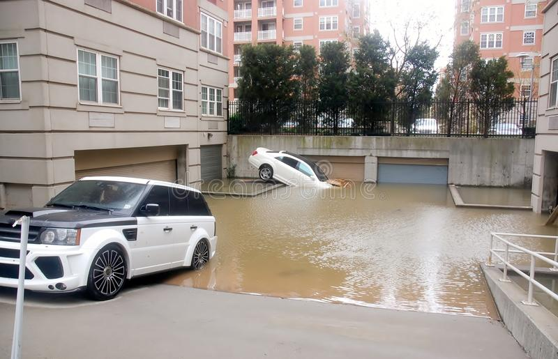 Flooding cars. Luxury cars flooding after superstorm in New York, areas of basements and garages of luxury condos under the water,car owners believe that royalty free stock photo