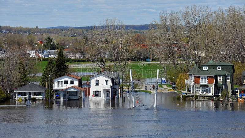 Flooding in Gatineau, Quebec, Canada. Gatineau, Canada - May 10, 2017: The severe flooding on Rue Jaques-Cartier along the Quebec side of the swollen Ottawa royalty free stock photo