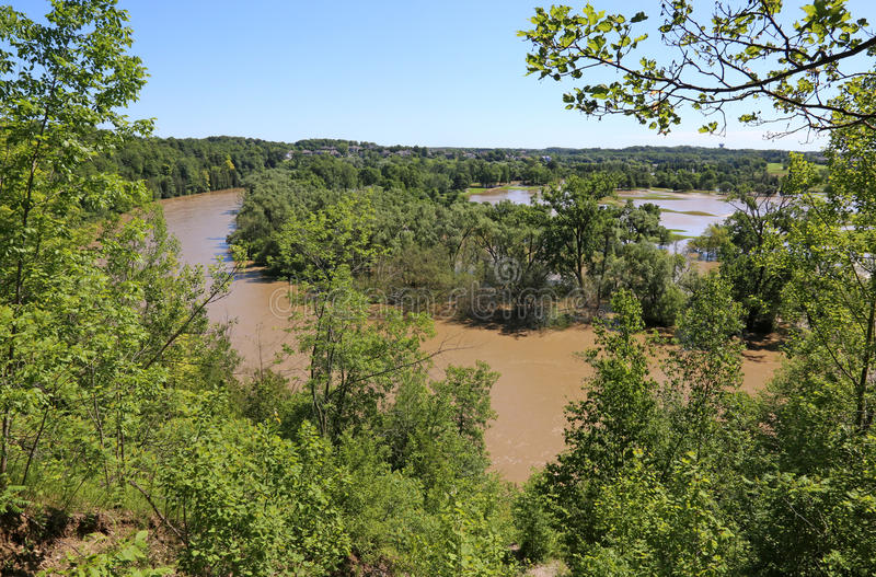 Flooding Grand River. KITCHENER, ONTARIO - JUNE 24, 2017: The Grand River overflowing into Deer Ridge Golf Club due to heavy rains stock photos