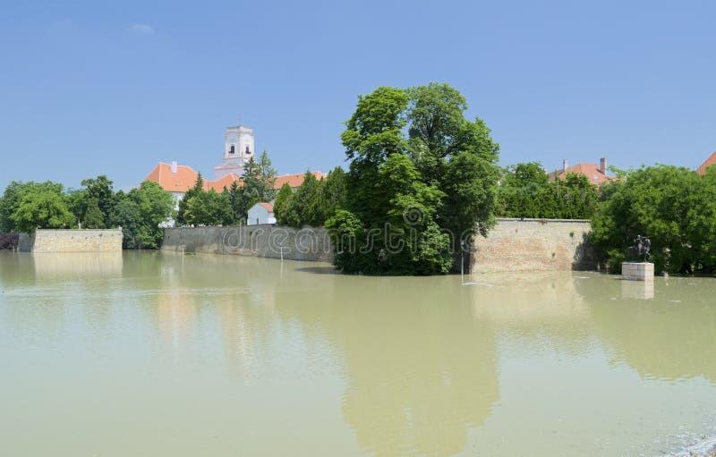 Flooding River at Bishop Castle. Flooding Raba River at Bishop Castle Walls in Gyor, Hungary stock photography