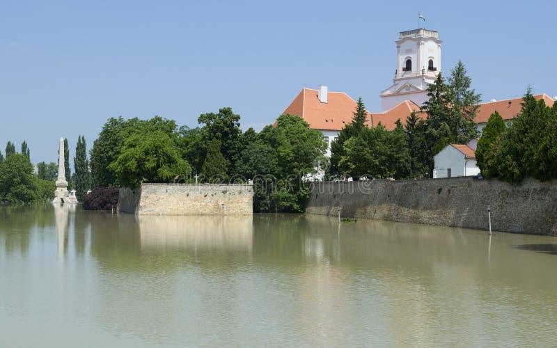Flooding River at Bishop Castle. Flooding Raba River at Bishop Castle Walls in Gyor, Hungary royalty free stock photos