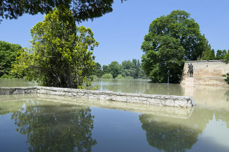 Flooding River at Castle Walls. Flooding Raba River at Bishop Castle Walls in Gyor, Hungary stock photo