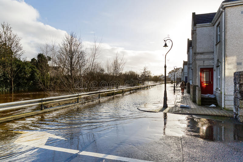 Flooding river in an irish town. Photo of a flooding river in an irish town stock photo