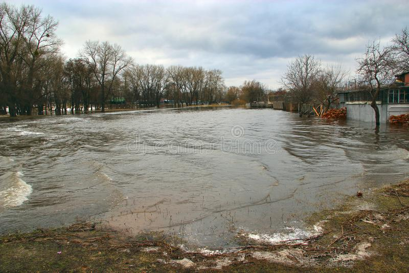 Flooding of river in spring in town during melting of snow. Natural disaster. Flooding of river in spring in town during melting of snow. Flooding city. Flood royalty free stock images