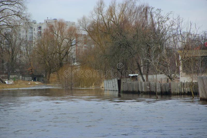 Flooding of river in spring in town during melting of snow. Natural disaster. Chernihiv / Ukraine 02 April 2018: Flooding of river in spring in town during stock image