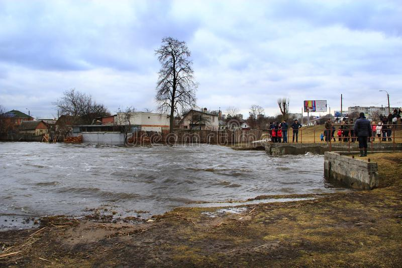 Flooding of river in spring in town during melting of snow. Natural disaster. Chernihiv / Ukraine 02 April 2018:Flooding of river in spring in town during royalty free stock image