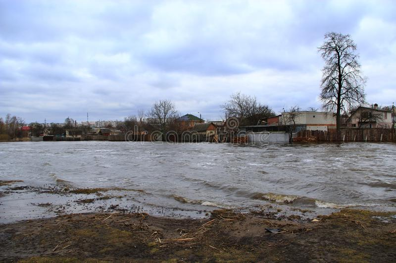 Flooding of river in spring in town during melting of snow. Natural disaster. Chernihiv / Ukraine 02 April 2018: Flooding of Stryzhen river in spring in stock photos