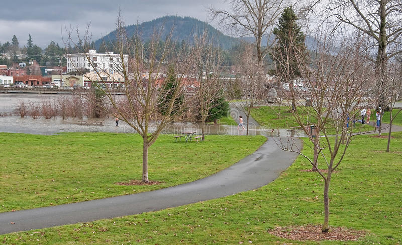 Flooding of the Skagit River WA. MT VERNON, WA – JANUARY 16: - Flood waters from Skagit river poured over the banks recently as kids enjoy the time. The royalty free stock photo