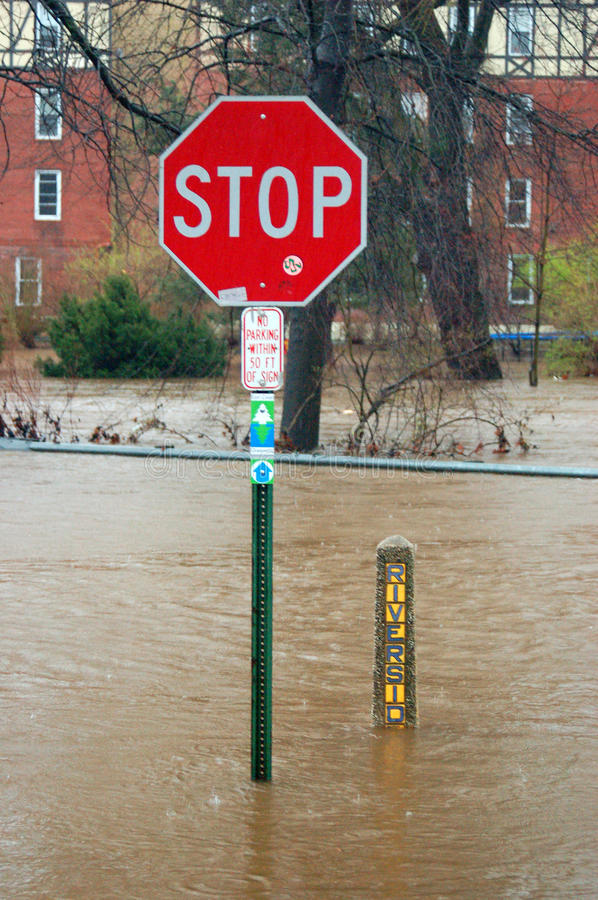 Flooding is a suburban town. Flooded Road Following a Severe Storm in American Suburb stock photo