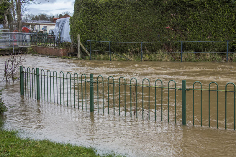 Flooding - Yorkshire - England. Flood water flowing down the street after the River Derwent burst its banks in the village of Stamford Bridge in North Yorkshire stock photos