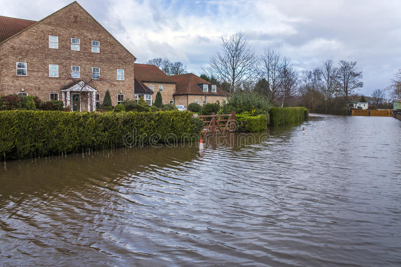 Flooding - Yorkshire - England. Flooding after the River Derwent burst its banks in the village of Stamford Bridge in North Yorkshire in northeast England royalty free stock image