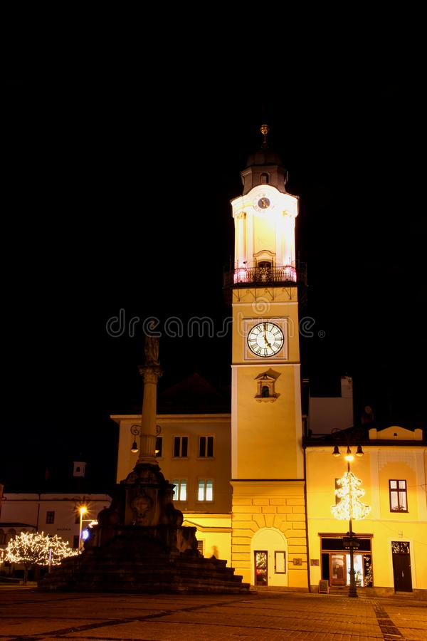 Floodlit clock tower in main square of Banska Bystrica Slovakia royalty free stock photos