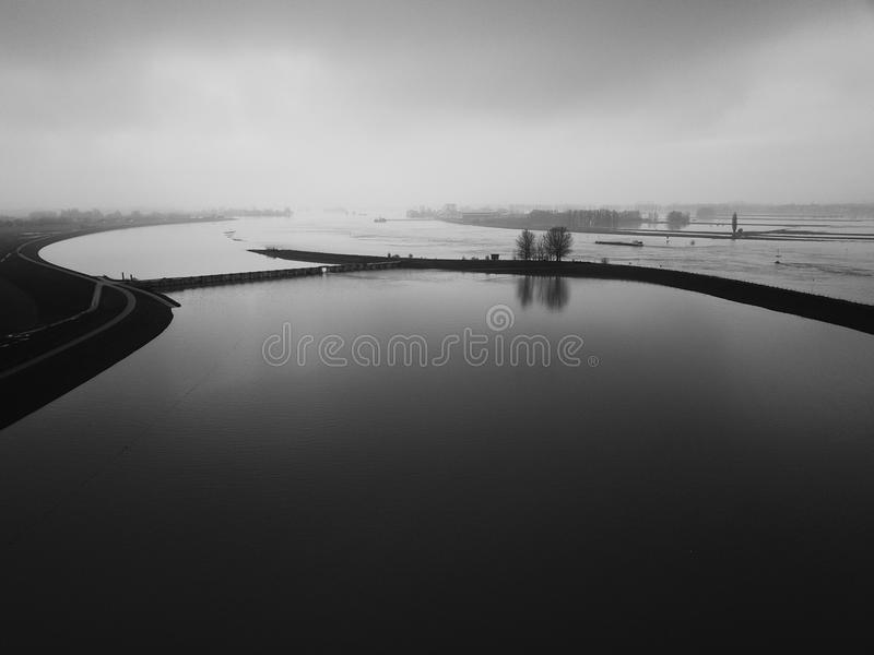The floodplains. In the Netherlands at the small village of Westervoort, where the river divides itself into two. Precautions for the rising water levels in royalty free stock image
