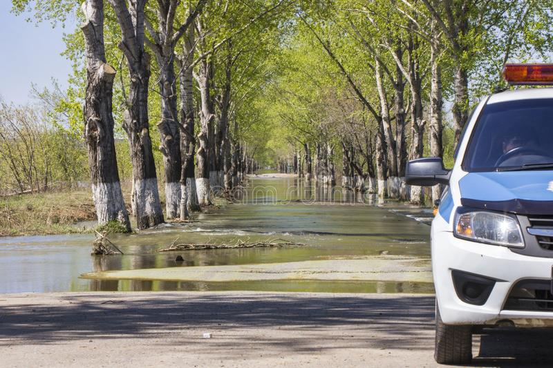 Floods have flooded a street. Flooding on a road stock image