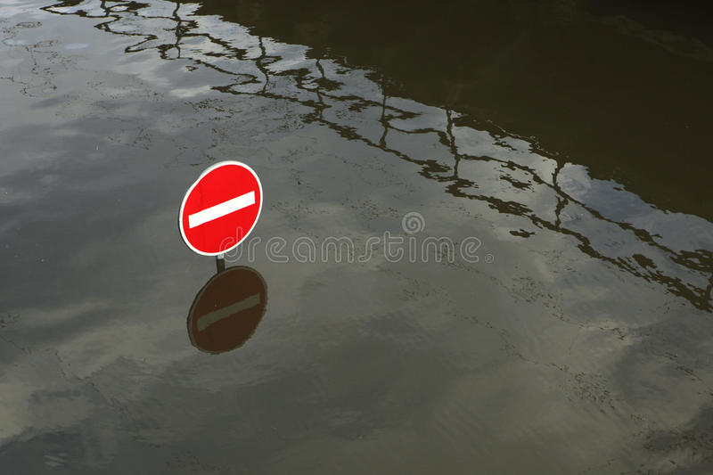 Floods in Usti nad Labem, Czech Republic. USTI NAD LABEM, CZECH REPUBLIC - JUNE 5, 2013: No entry for vehicles, a traffic sign flooded by the swollen Elbe River royalty free stock photo