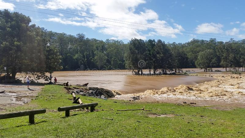 Floodwaters Oxenford Australia. Flood Waters at the Coomera River Weir, Queensland Australia stock images