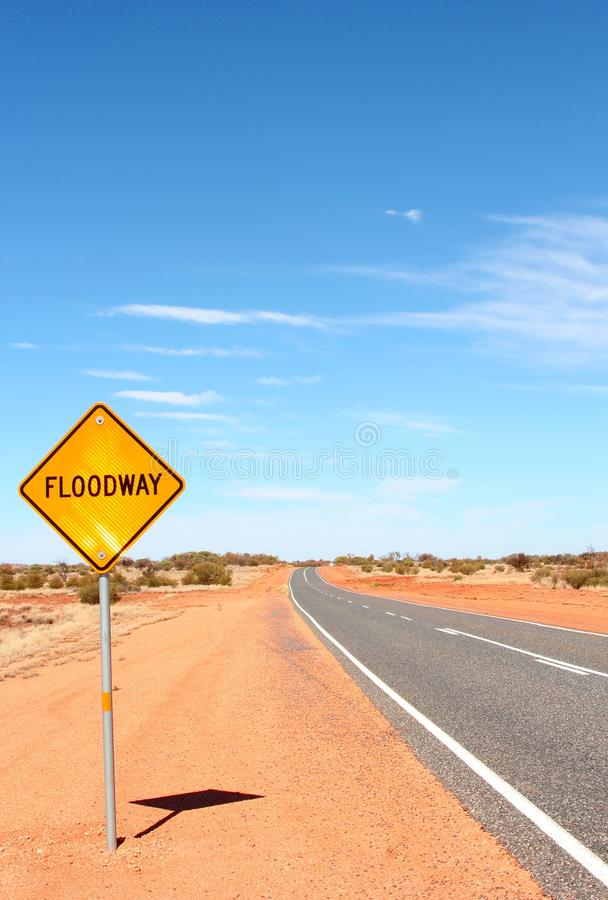 Floodway warning sign in the Australian deserts. Floodway warning sign along the Lasseter Highway and the Stuart Highway in the Red Centre of the Australian royalty free stock photography
