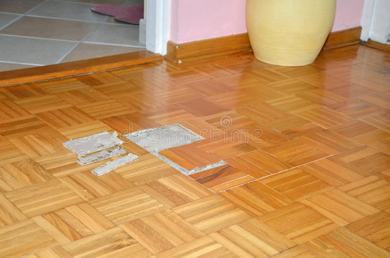 Floor in Apartment with Damaged Parquet stock photos
