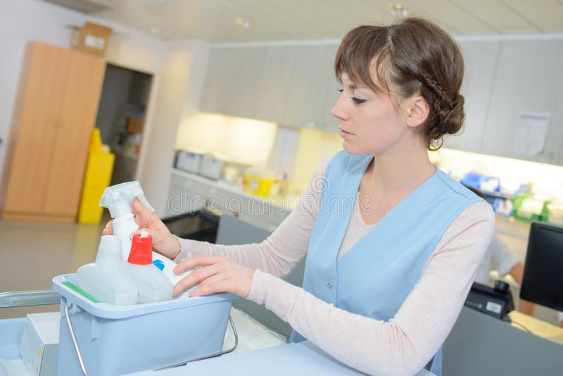 Floor care and cleaning services in hospital. Female stock images