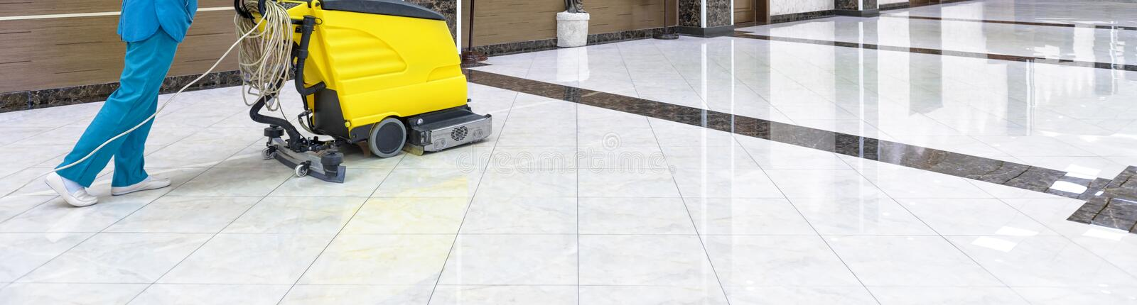 Floor care with washing machine in an office stock image