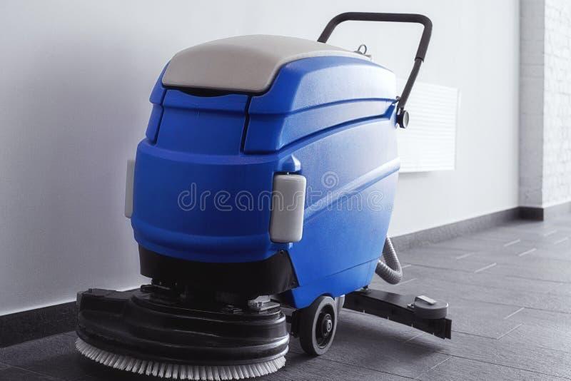 Floor cleaning machine. Standing on black stone floor royalty free stock photos