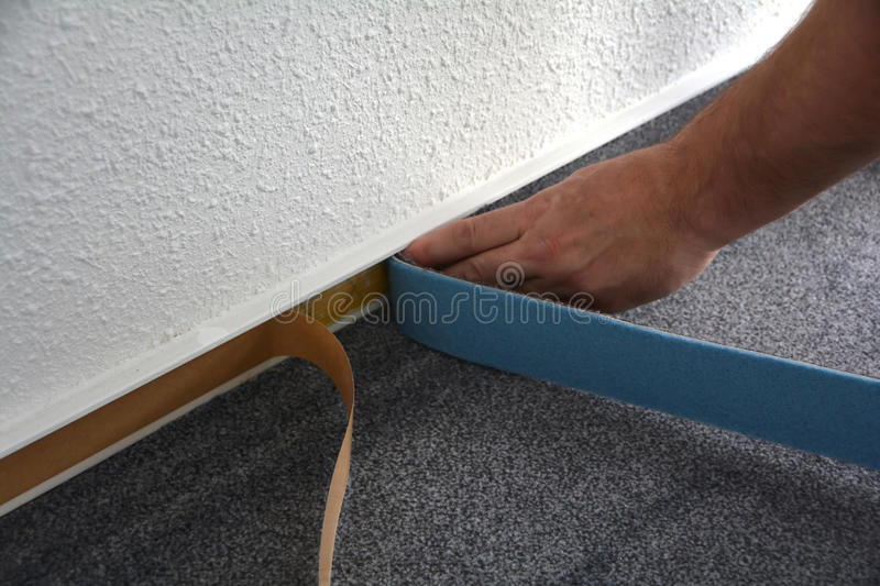 A floor fitters at work royalty free stock photo