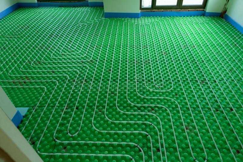 The floor heating system - new home installation. With white pipes stock images